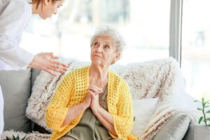 an elderly woman is emotionally abuse by a female caregiver