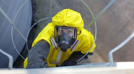 chemical plant employee working
