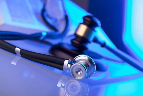 medical stethoscope and a gavel