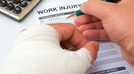 worker filling out work injury claim form