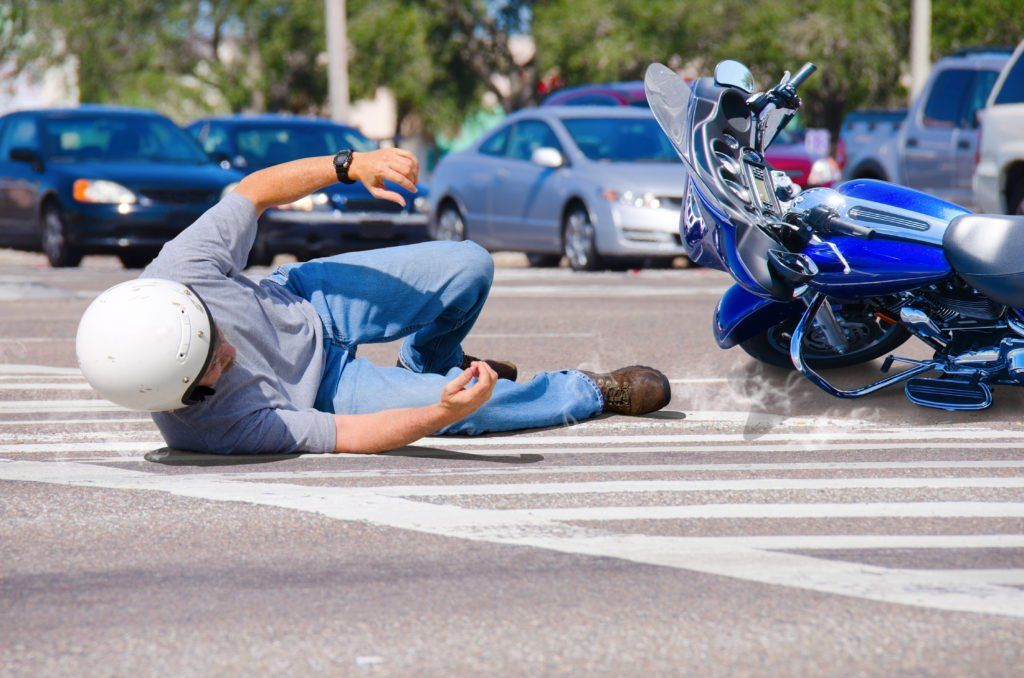 motorcycle rider in an accident at intersection