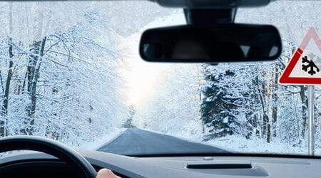 holiday travel on snowy road