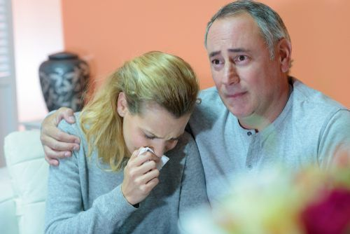 couple crying over the loss of a loved one