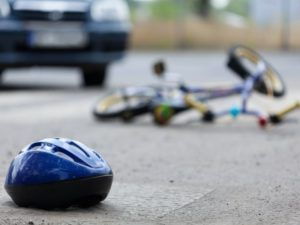 BicycleAccident Liability in Hawaii helmet and bicycle on the road