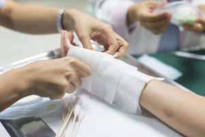 Patient Getting Medical Care To Hand