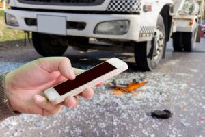 18 wheeler accident person holding phone
