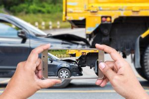 Person Taking Picture of Accident with Phone