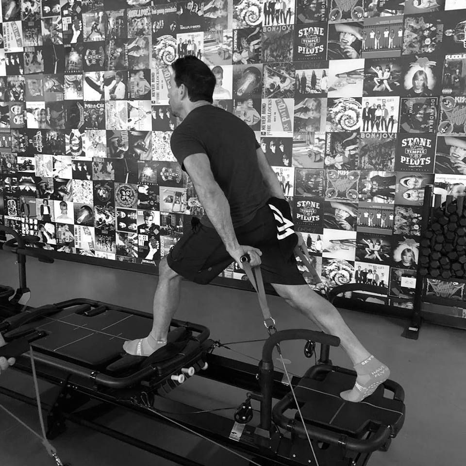 man working out at a pilates inspired workout at Corus45