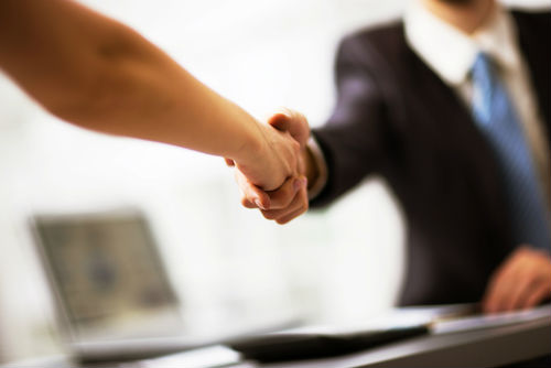 Slip and fall attorney shaking hands with client