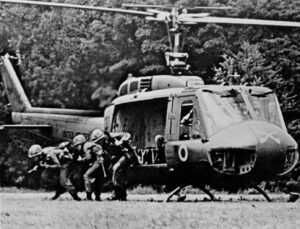 Soldiers deploying from a war helicopter