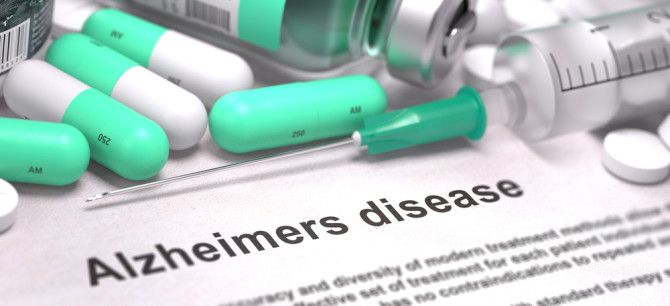 """Image of medical supplies with text that reads """"Alzheimers disease"""""""