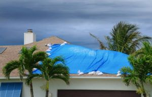 property damage on the roof of florida home after hurricane