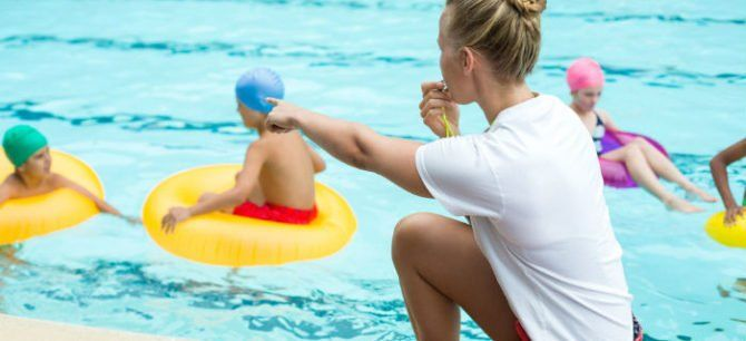 lifeguard watching over a pool to prevent accidents