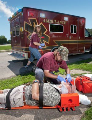 Man bring assisted with spinal cord injury