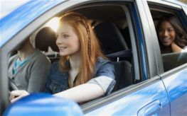 young teen driving a car