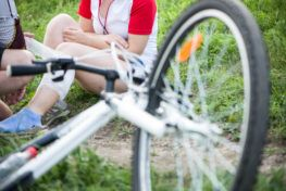 Damaged bike and injured bicycle rider that will need a Corpus Christi bicycle accident lawyer.