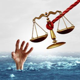 justice scale being offered to save a drowning person as a symbol of attorney services solving problems