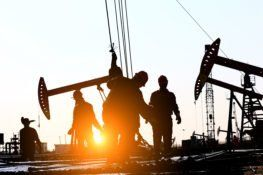 workers on texas oil drilling work site