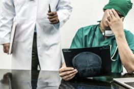doctor looking at xray image