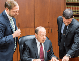 Picture of three McAllen Injury lawyers at Herrman & Herrman