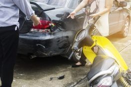 2 drivers discussing over a motorcycle and car crash
