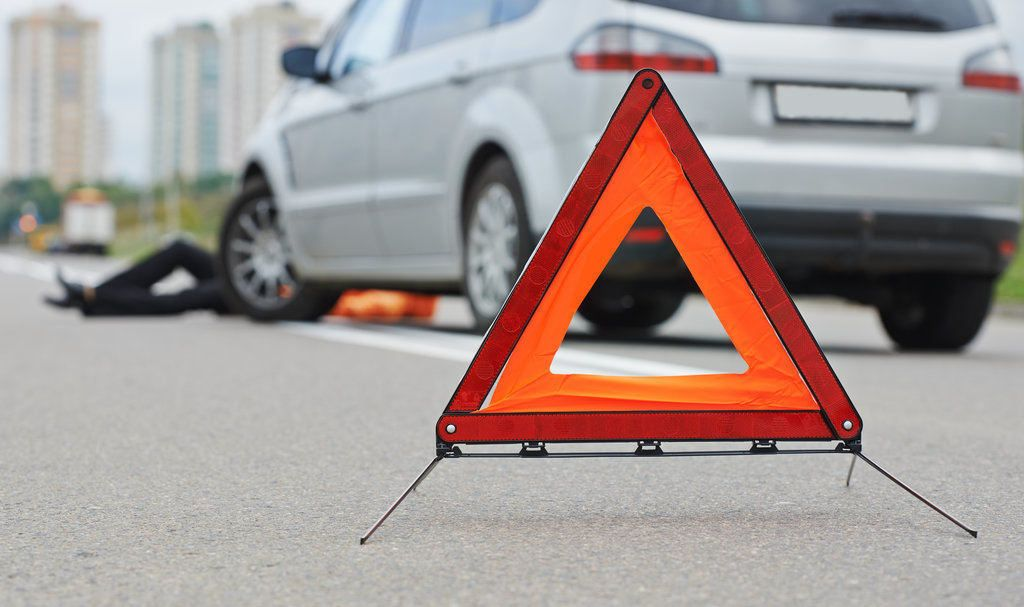 car triangle warning due to pedestrian accident