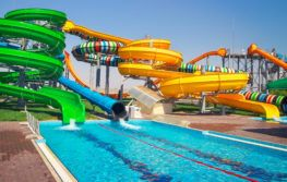 empty waterpark with green and yellow slide