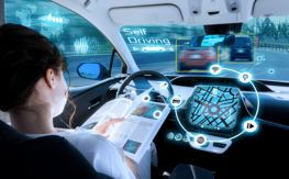 A woman reading while using automated automobile