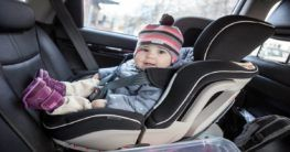 a child on a car seat