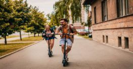 a man and a woman enjoying scooter ride