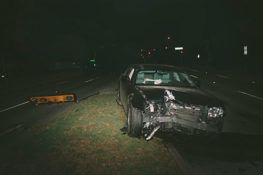 wrecked black car