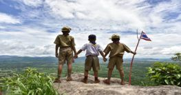three boy scouts looking at the top view