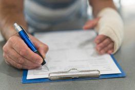 injured man filling personal injury claim form