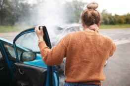 woman experiencing a neck pain after a car accident