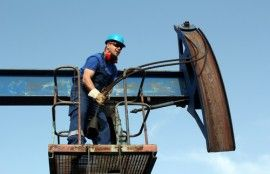 McAlester oil field worker on the job.