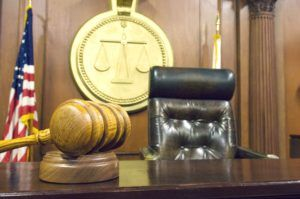 Inside the courtroom with gavel near judge's chair in Tulsa.