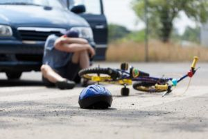 A man is injured after his bicycle is hit by a car in McAlester.