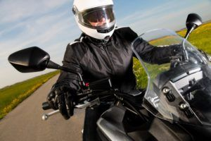 Motorcycle driver on safety gear.
