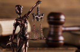 Personal injury law concept with statue justice.