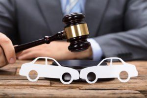 A Muskogee car accident lawyer holds a gavel.