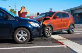 Car accidents happening along the intersection lanes.