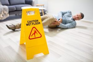 Man holding his leg after a slip and fall accident