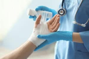 doctor is doing dressing of their patient hand