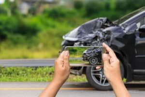 car owner is taking photo of their accidental car - Car accident lawyer