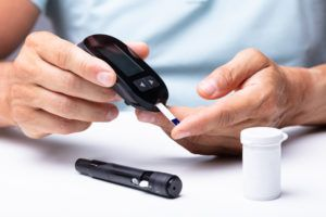 checking blood sugar levels with a medical device reader