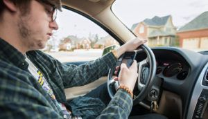 One of the most common distractions in Texas roads is Facebook use while driving.