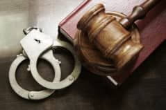 Handcuffs and gavel representing the NJ penal code's laws for extradition