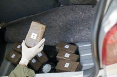 sealed drugs packages being checked by authorities
