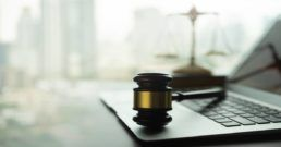 gavel on a computer representing computer crimes
