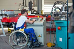Man working in wheelchair while on workers compensation